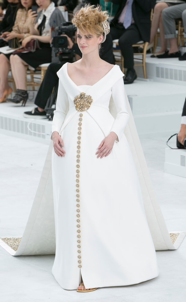 Chanel has a solution for mom's to be that are brides to be with this bustled creation. Note the peak of sandals..this girl is comfortable.
