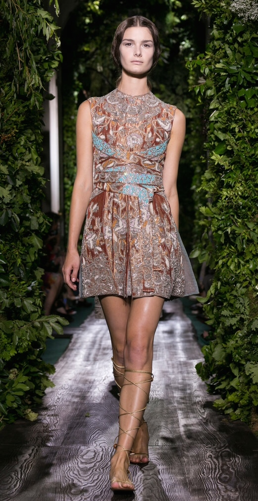 Valentino's Modern shape (and length) with baroque styled tapestry and grecian sandals is stunning. Again, very simple adornment.