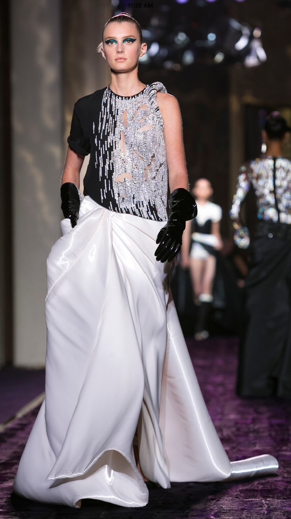 There's no truer evidence that street style has transcended seen in Versace's gown. It manages to look comfortable and glamorous at the same time. The leather gloves add texture, the slouch of them add to the overall casual effect.