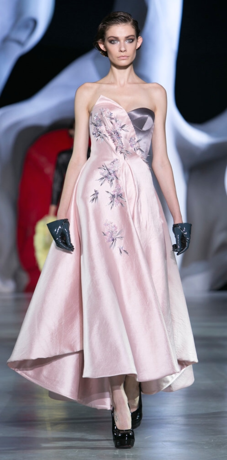 Ulyana Sergeenko's innocence refined. Look at the reimagined gloves in patent leather...just the right amount of naughty with this otherwise sweet gown.