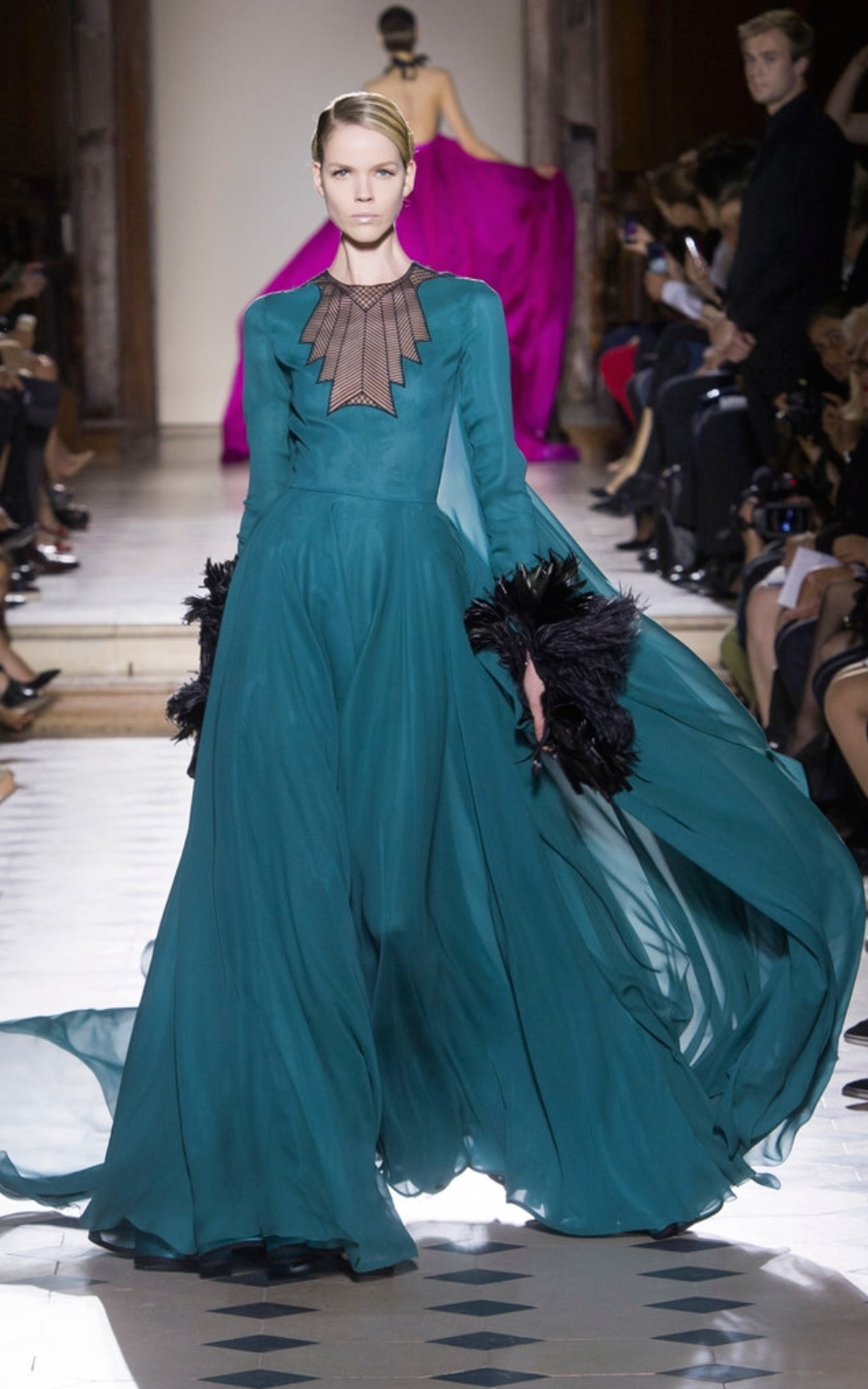 Julien Fournié infused art deco glamour into this gown at the neckline and the feathered cuffs.