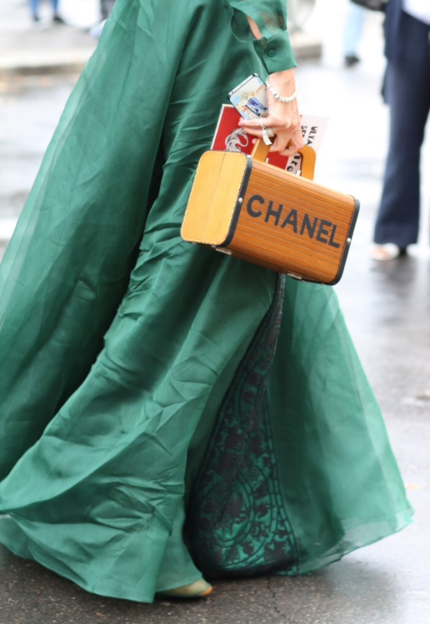 """..and here a faceless """"complex"""" comrade wearing her Cinderella dreams in style...adorned in vintage Chanel and cell phone. Brava Cindy!"""