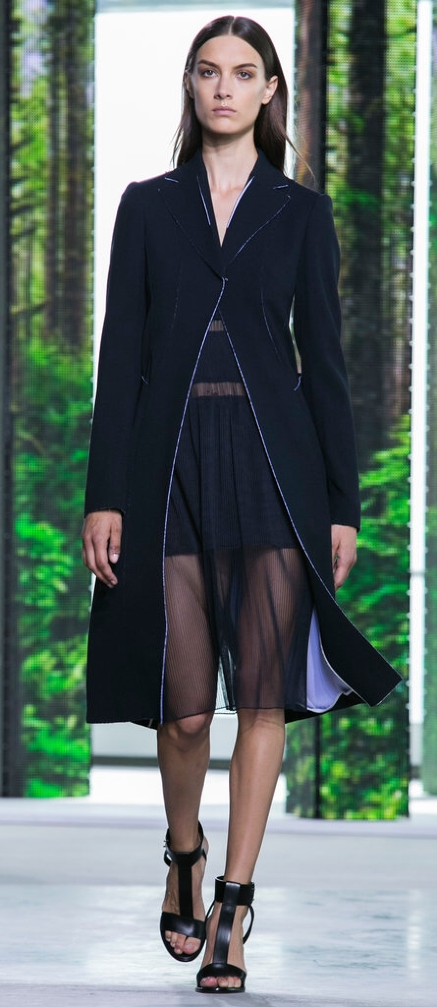 The overcoat with Hugo Boss's mini-sheer-maxi gives structure to the whimsy.