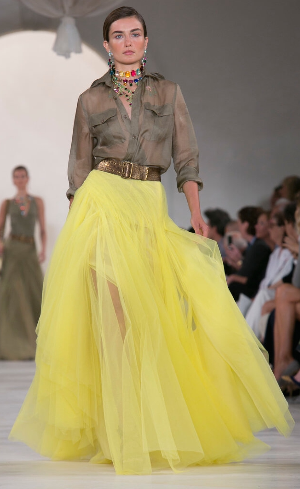 Ralph Lauren's safari tones are brightened with yellow tulle and a sheer iridescent button down shirt.