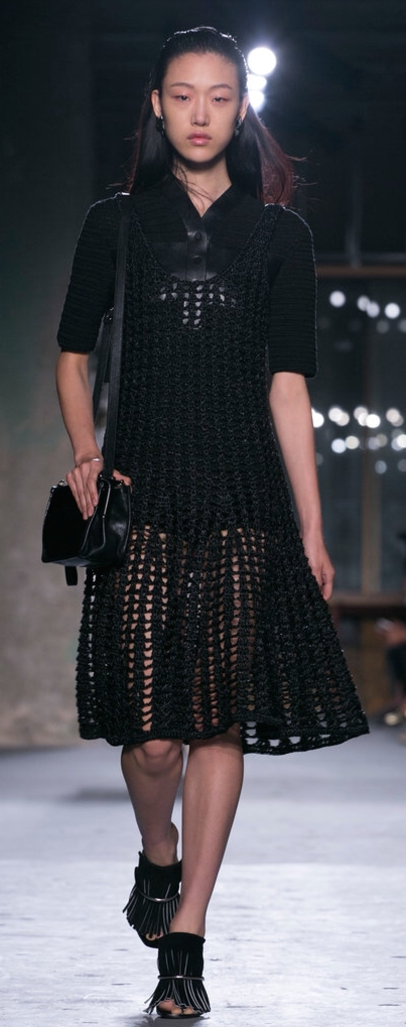 Proenza Schouler uses a heavy, wide-eyelet knit over a leather short jumper to communicate transparency.