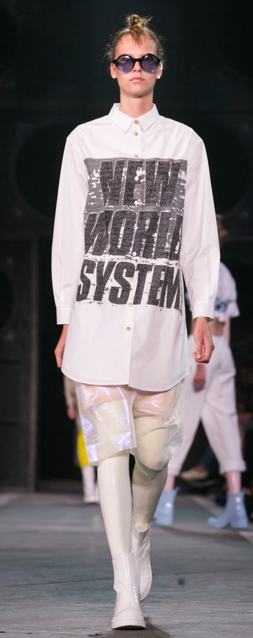 The oversized shirt is paired with sheer iridescent walking shorts and tights for opacity (Marc by Marc Jacobs)