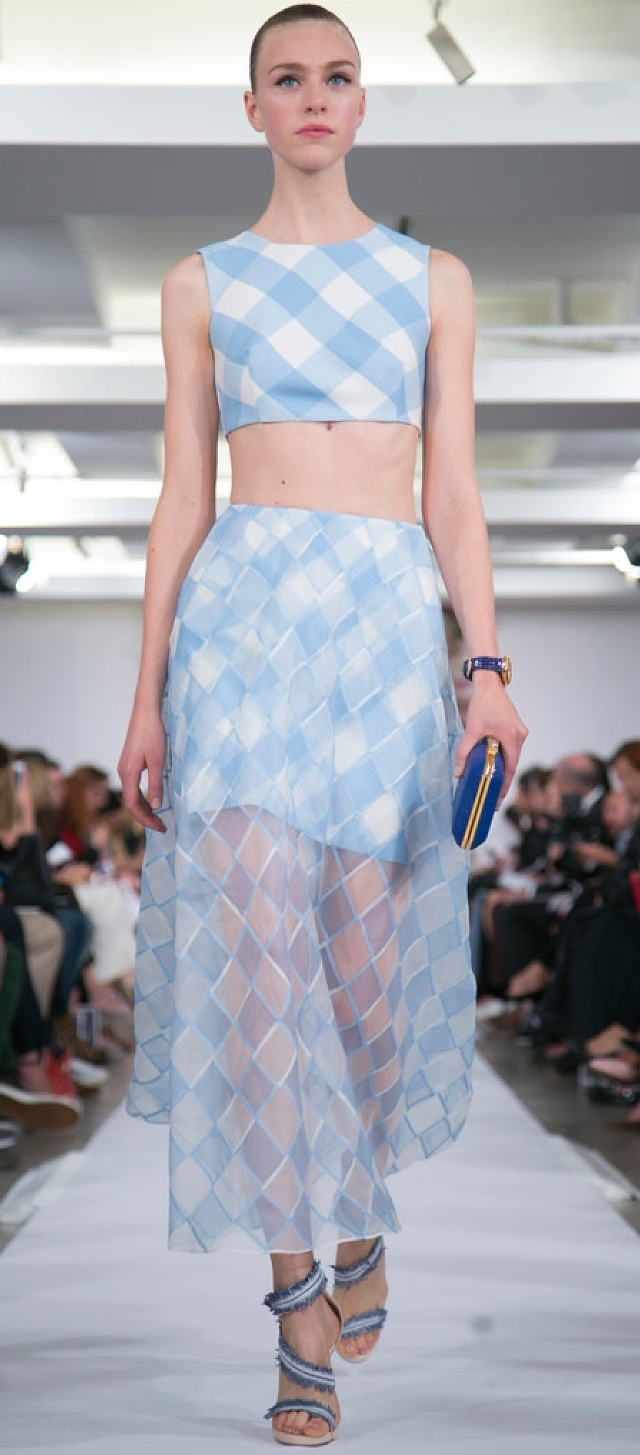 Oscar DeLa Renta uses a sheer patterned check as an ankle length skirt over a solid white mini.