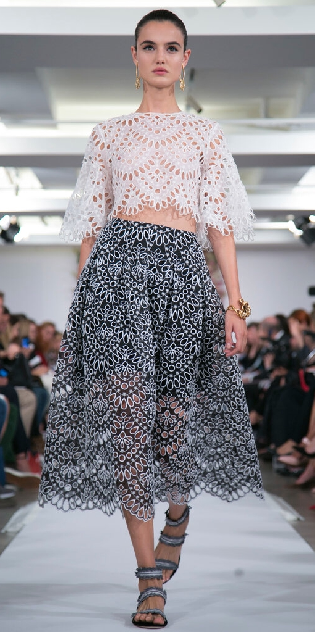 Patterned eyelet lace on top and bottom gives an allover transparent feel to these pieces. (Oscar de la Renta)