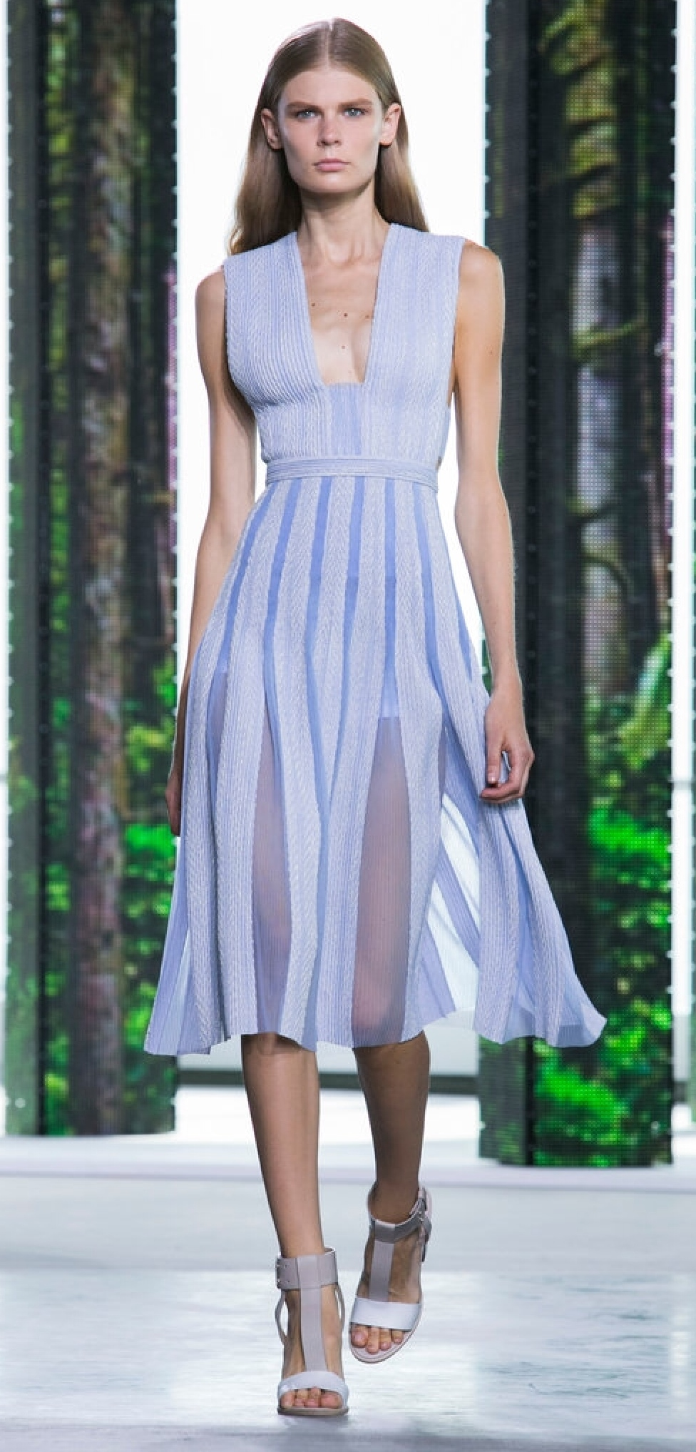 The pleated skirt of this fit and flare dress flutters out with sheer panels at the folds. (Hugo Boss)