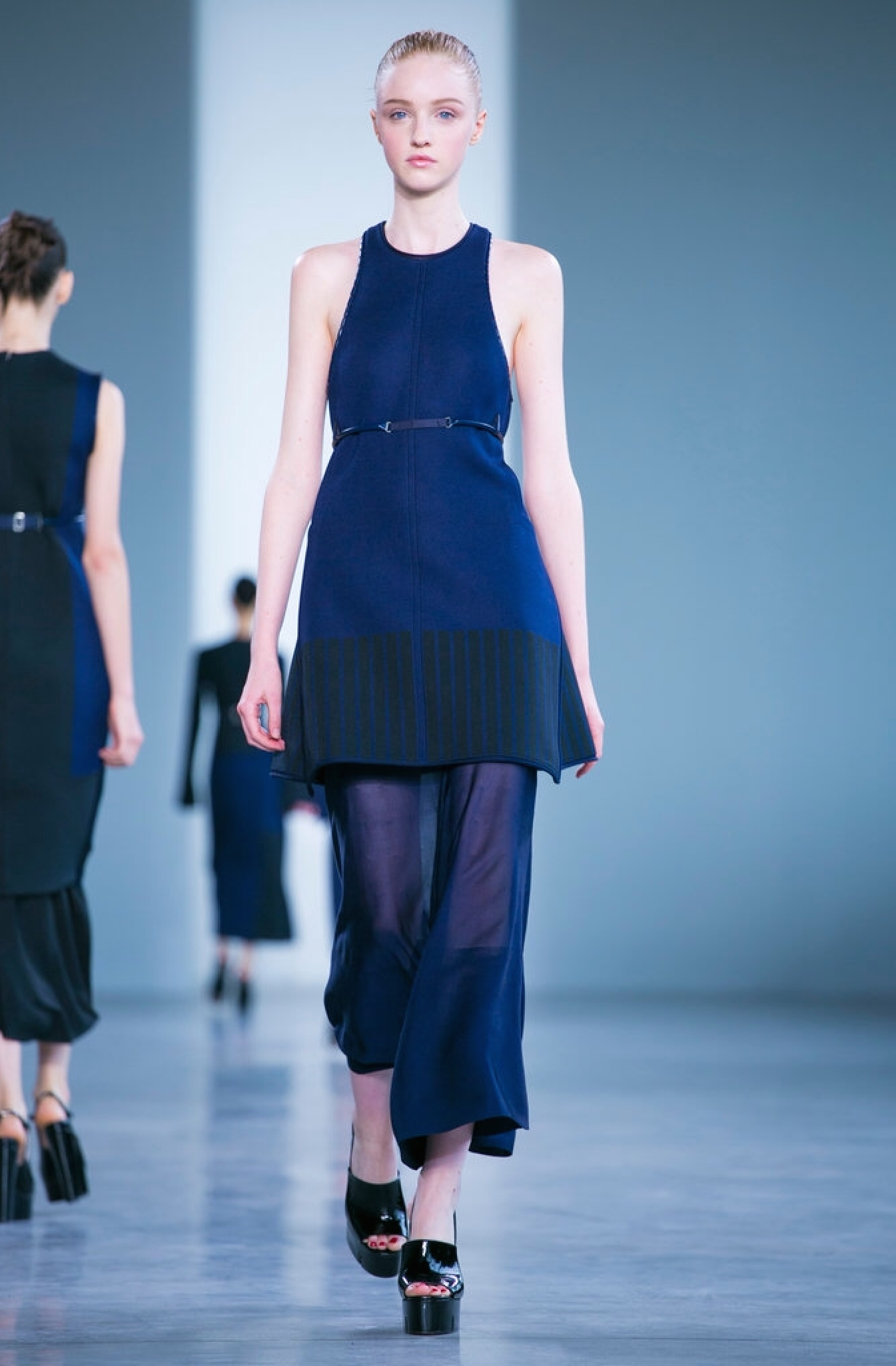 Calvin Klein pairs sheer culottes with a sleeveless sweater tunic.