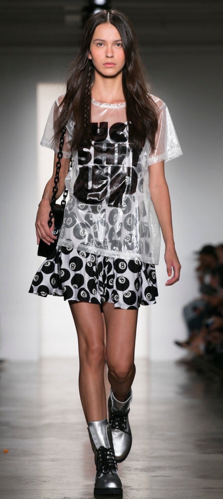The shirt is completely transparent, but worn over a dress maintains its modesty...sans the message, of course. (Jeremy Scott)