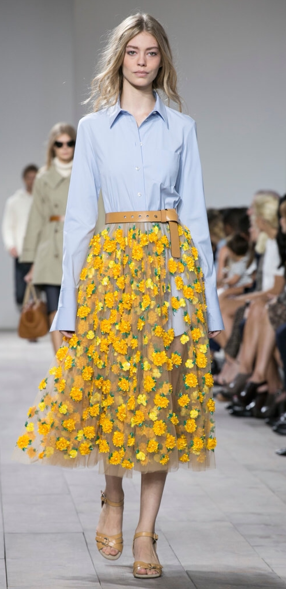 Michael Kors used skin-toned layers topped with flowers which gives the feeling of walking through the garden...gorgeous!