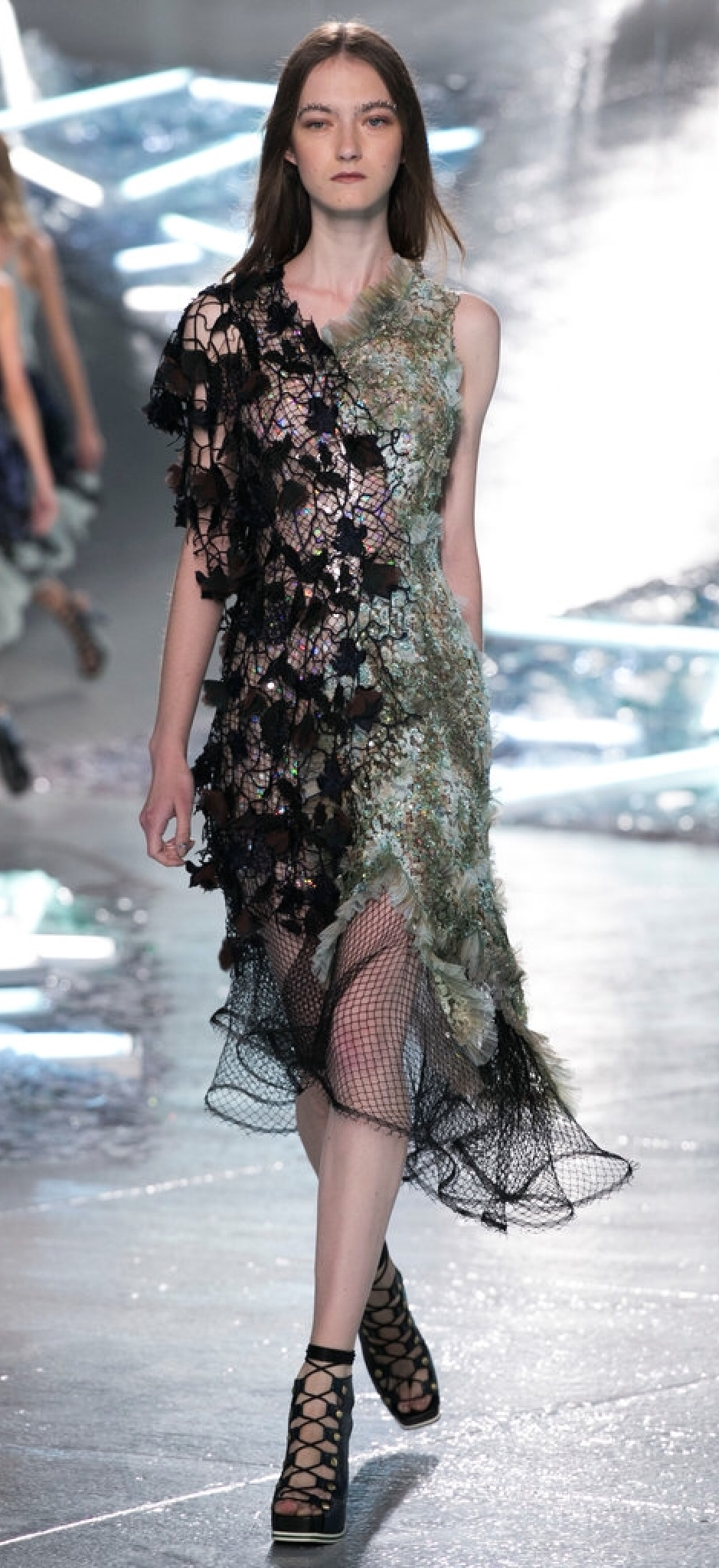 Rodarte's mixed media dress uses mesh, feathers and fringe...falling in all the right places of coverage.