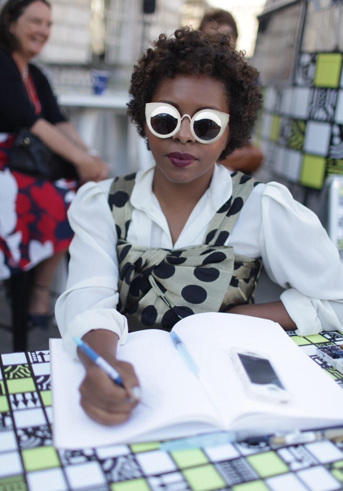 A fashion week attendee wearing Quay sunglasses.
