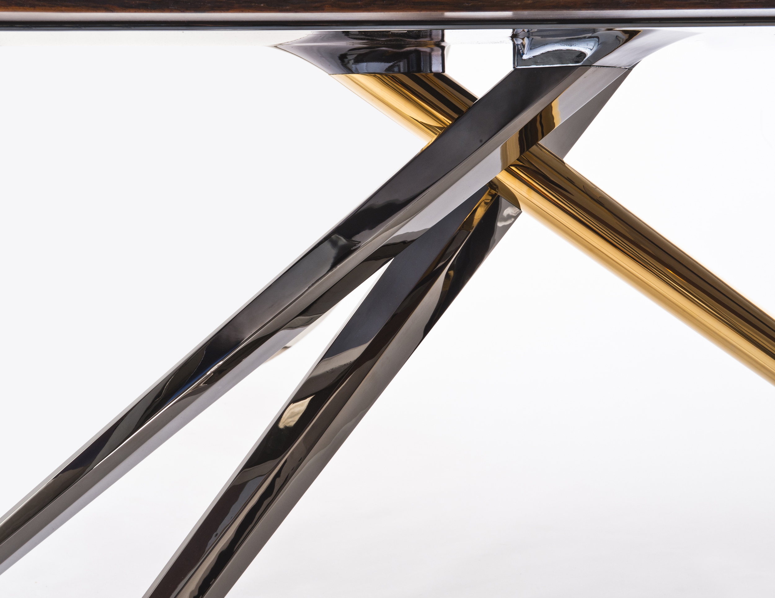 Aluminum bar stock legs, plated in dark  chrome and 24k gold.