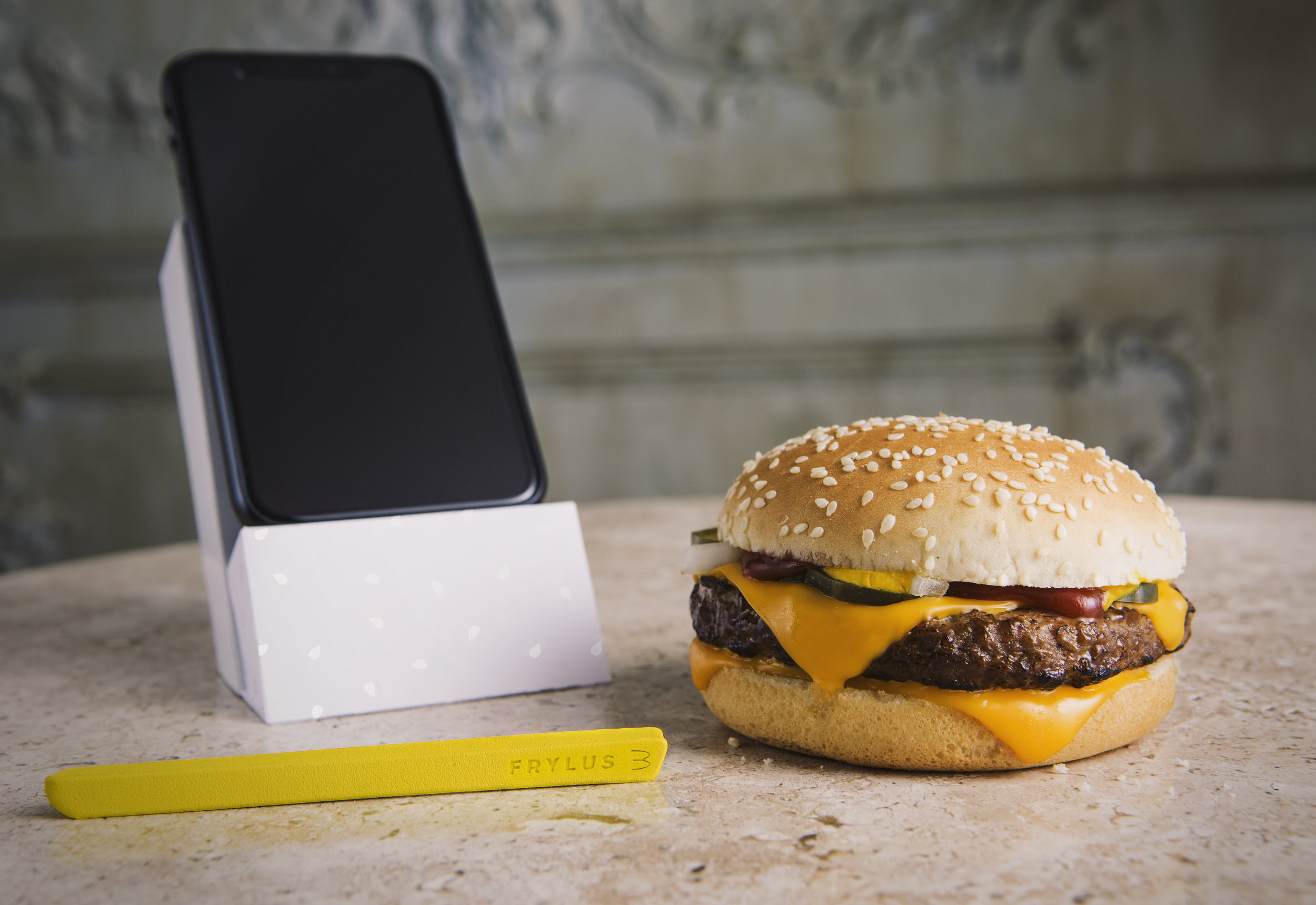 Frylus, Quarter Pounder, and Packaging - The packaging that the Frylus came in could be folded into a phone stand so that you could take a selfie while holding your burger and Frylus.