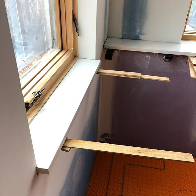 Progress on the interior of a new master bathroom. . Solid surface sill and drywall returns around the windows. . In-floor heating using the Schluter system with their uncoupling underlayment, and a wire laid into the underlayment and running up to a thermometer in the wall. Tile install starts tomorrow! . . . #studiowilde #sjw #construction #kansascity #westwoodhills #addition #residential #residentialdesign #residentialconstruction #designbuild #construction #architecture #interiors #interiordesign #schluter #schlutersystem