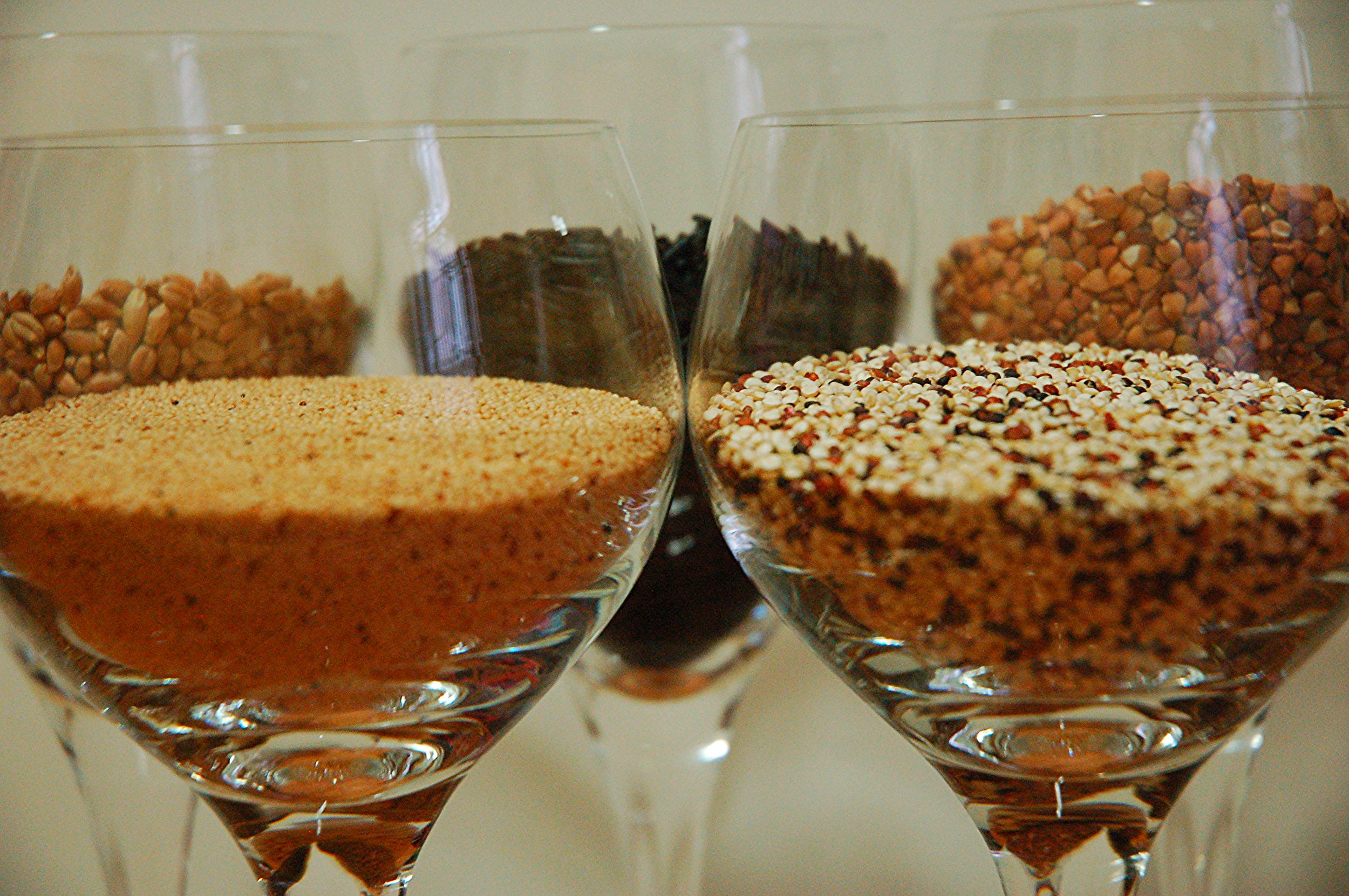 Clockwise from left background: spelt, wild rice, kasha, quinoa, & amaranth