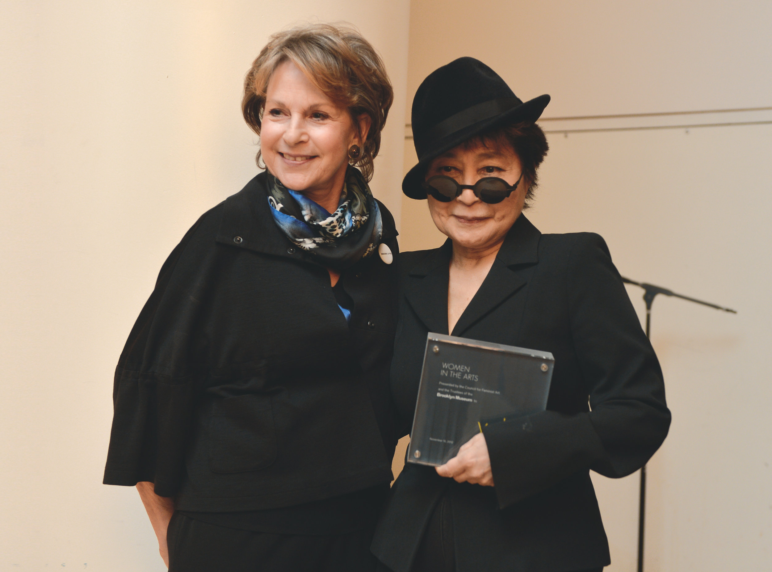 Photo Credit © 2012 Philip Greenberg.  IN THIS IMAGE  Elizabeth A. Sackler and Yoko Ono November 15 2012  Brooklyn Museum Yoko Ono Tenth Annual Women in the Arts Benefit Luncheon  Introduction by Museum Director Arnold L. Lehman followed by a conversation between Ono and Catherine Morris, Curator of the Elizabeth A. Sackler Center for Feminist Art.  Multi-media Conceptual artist Yoko Ono was be honored at the tenth annual Women in the Arts luncheon Thursday, November 15, 2012. Proceeds from the event benefited the many educational and artistic programs offered by the Brooklyn Museum and its Elizabeth A. Sackler Center for Feminist Art.  The program began at 11 a.m. with an introduction by Museum Director Arnold L. Lehman followed by a conversation between Ono and Catherine Morris, Curator of the Sackler Center. The program concludes with the presentation of the 2012 Women in the Arts Award to Ono and a reception and luncheon in the Museum's Beaux-Arts Court.