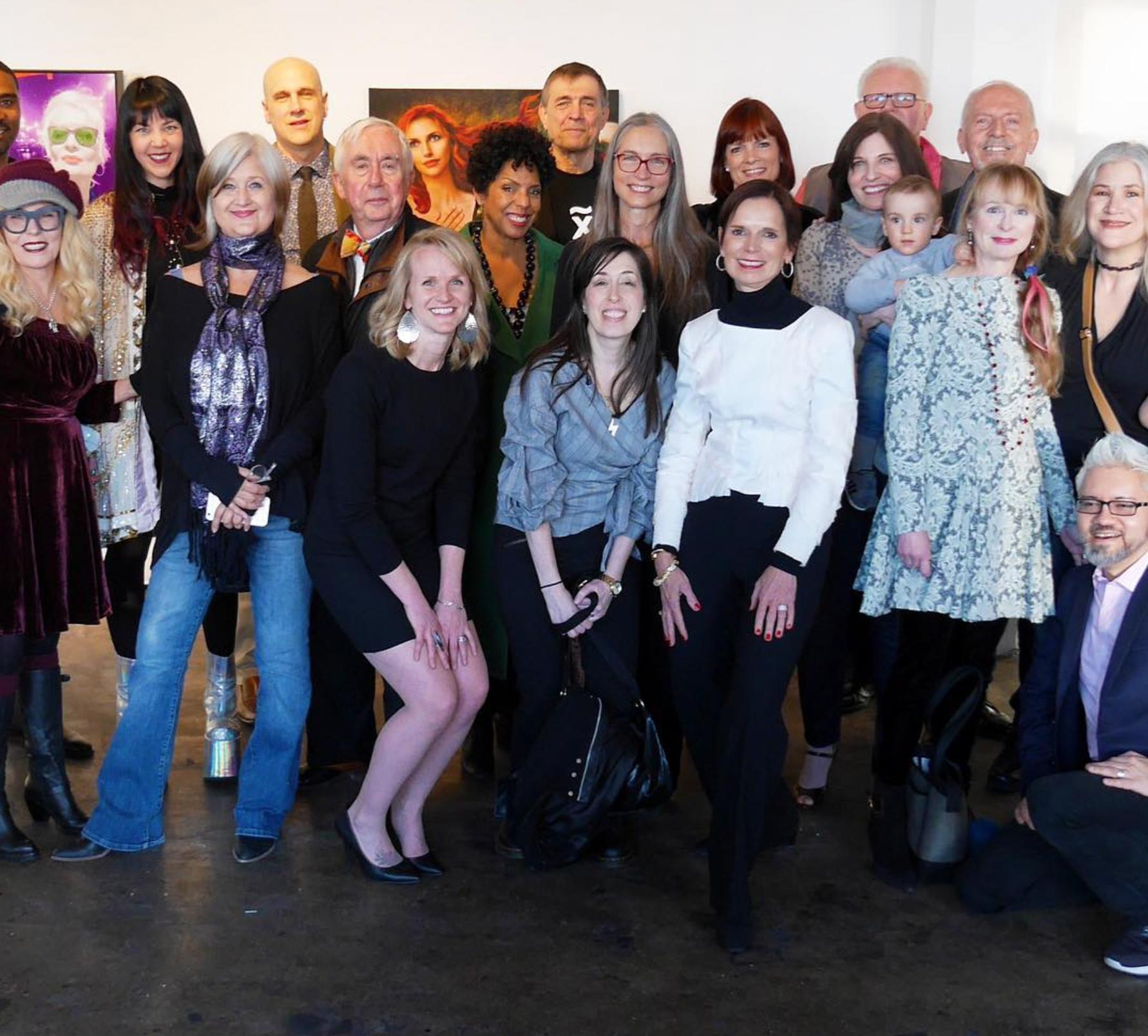 Dr. Elaine Melotti Schmidt, center white jacket, with artists