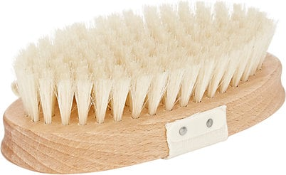 dry brushing - Whenever someone asks us how to fade away their cellulite or firm up their arms or legs we always suggest dry brushing. This exfoliation method is when you take a dry brush (like the one pictured) and buff your skin in circular motions while it's completely dry. This stimulates a lot of circulation and oxygen flow for your skin, helping it feel firmer. Results from this method aren't immediate. Consistently dry brushing your body every day or every other day is key to seeing your best results. You'll start noticing smoother, firmer skin in time!
