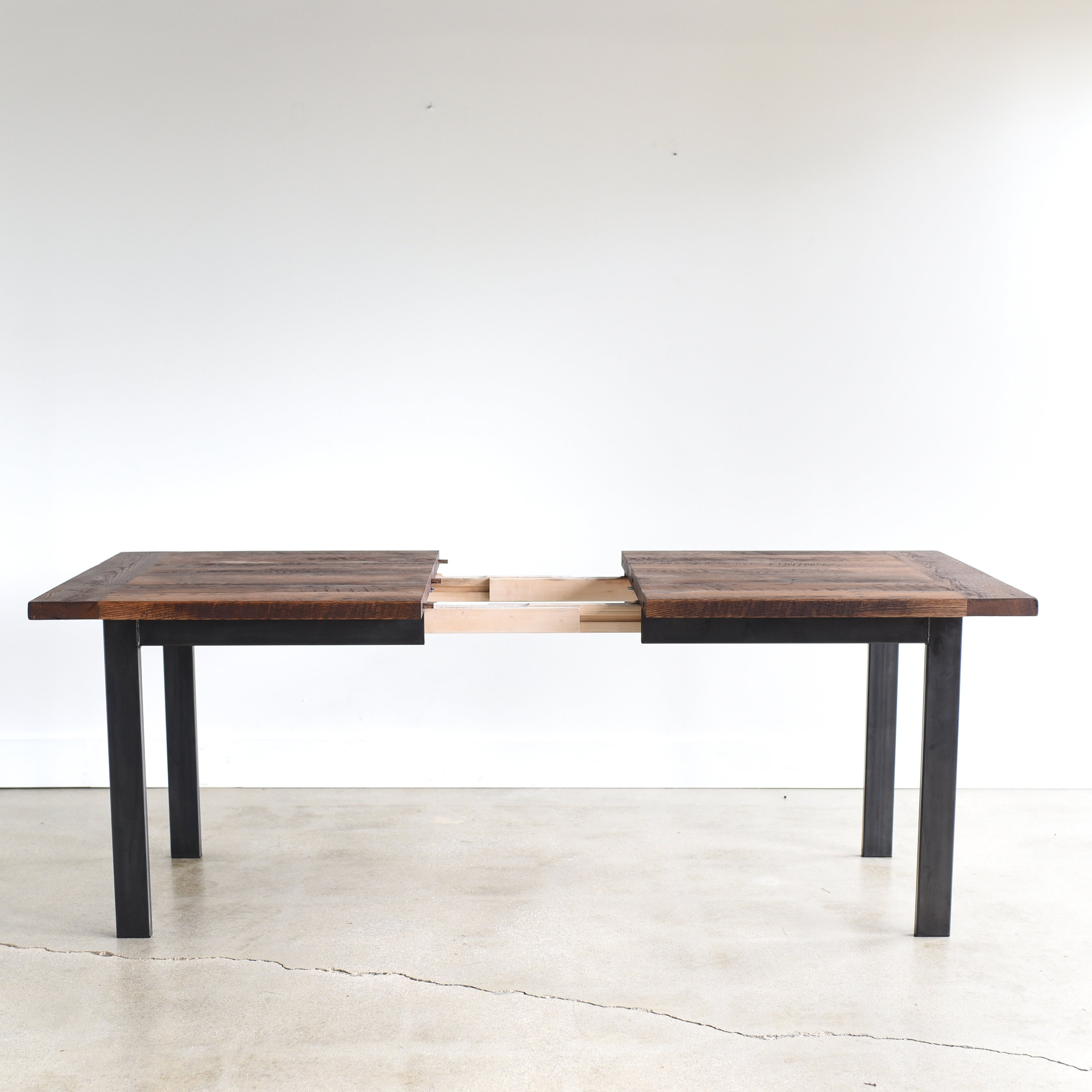 Picture of: Industrial Reclaimed Wood Extendable Dining Table What We Make