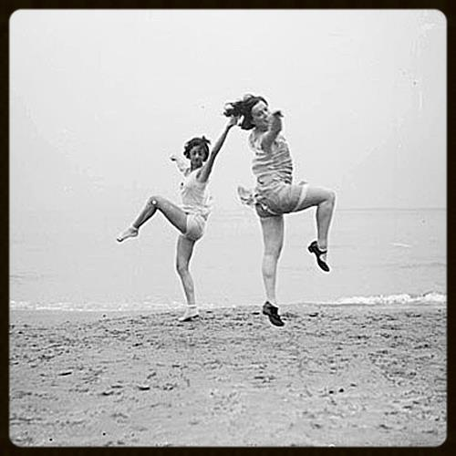 Two women performing a ballet dance at Oak Street Beach, Chicago, Illinois, 1928