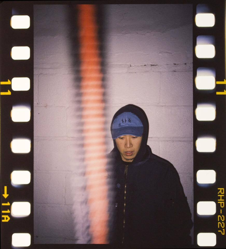 A self portrait of Jefford Lam; photographer, writer, designer, in our collaborative NTHNG runic logo hat dyed in indigo.