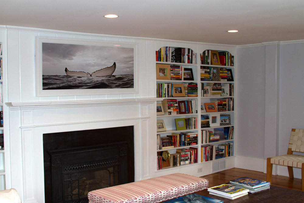 If ceiling height is an issue, choose a panorama with a narrow mat and frame to fill the area.