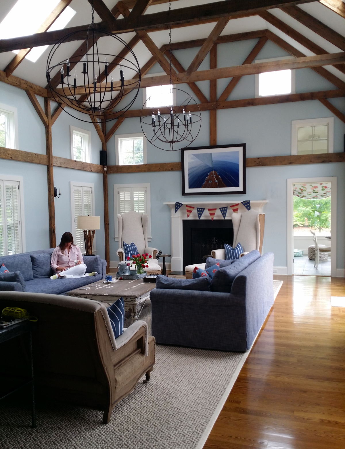 The tones in the wooden deck on the boat shown in this photograph are a great match to the wooden beams throughout this room.