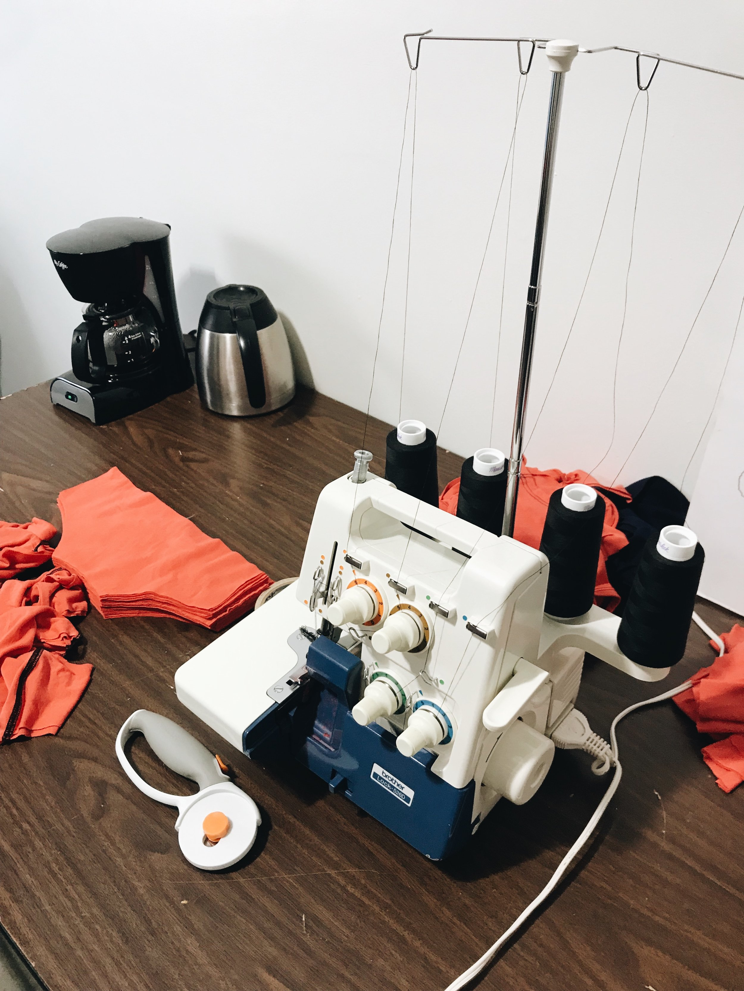 The women learn to cut fabric, sew on an industrial machine and finish with a serger.