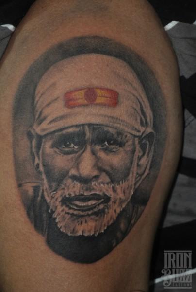 best+god+sai+baba+portrait+tattoo+design+by+best+tattoo+artist+in+mumbai+subhojit+chakroborty+eric+jason+dsouza+from+best+tattoo+parlour+studio+in+india+iron+buzz+tattoos+mumbai.jpg