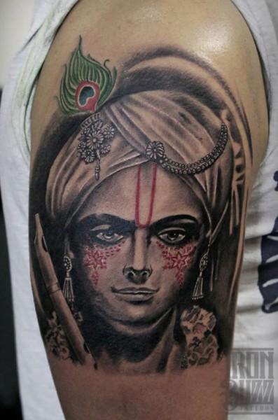 lord+krishna+religious+colour+peacock+feather+tattoo+design+by+best+tattoo+artist+in+mumbai+subhojit+chakroborty+eric+jason+dsouza+from+best+tattoo+parlour+studio+in+india+iron+buzz+tattoos+mumbai.jpg
