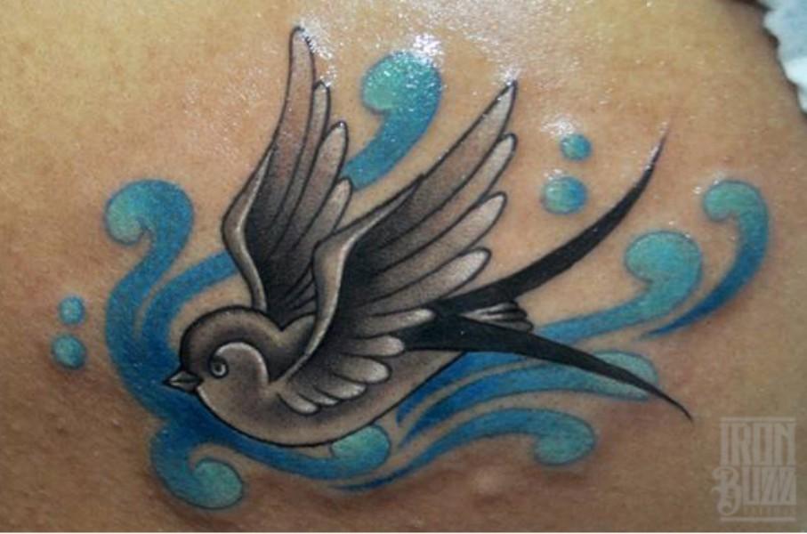 old+school+american+traditional+colourful+swallow+tattoo+design+by+best+tattoo+artist+in+mumbai+subhojit+chakroborty+eric+jason+dsouza+from+best+tattoo+parlour+studio+in+india+iron+buzz+tattoos+mumbai.jpg