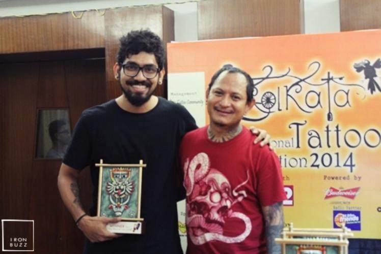 best-tattoo-artist-in-mumbai-india-eric-jason-dsouza-winning-best-black-and-grey-tattoo-award-at-international-kolkata-tattoo-convention-one.jpg