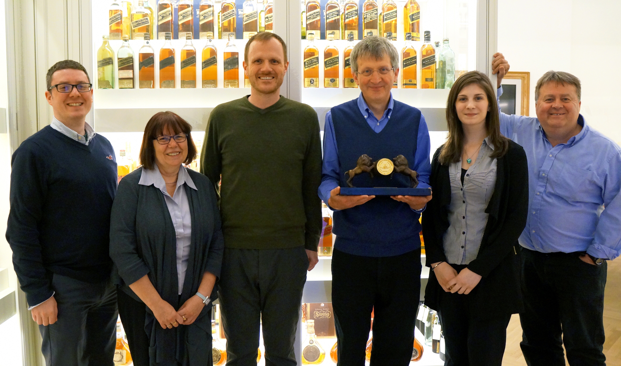 Jim Beveridge, Master Blender at Diageo, and his team receiving the Golden Barrel Trophy during a special award ceremony held at Diageo Archive.