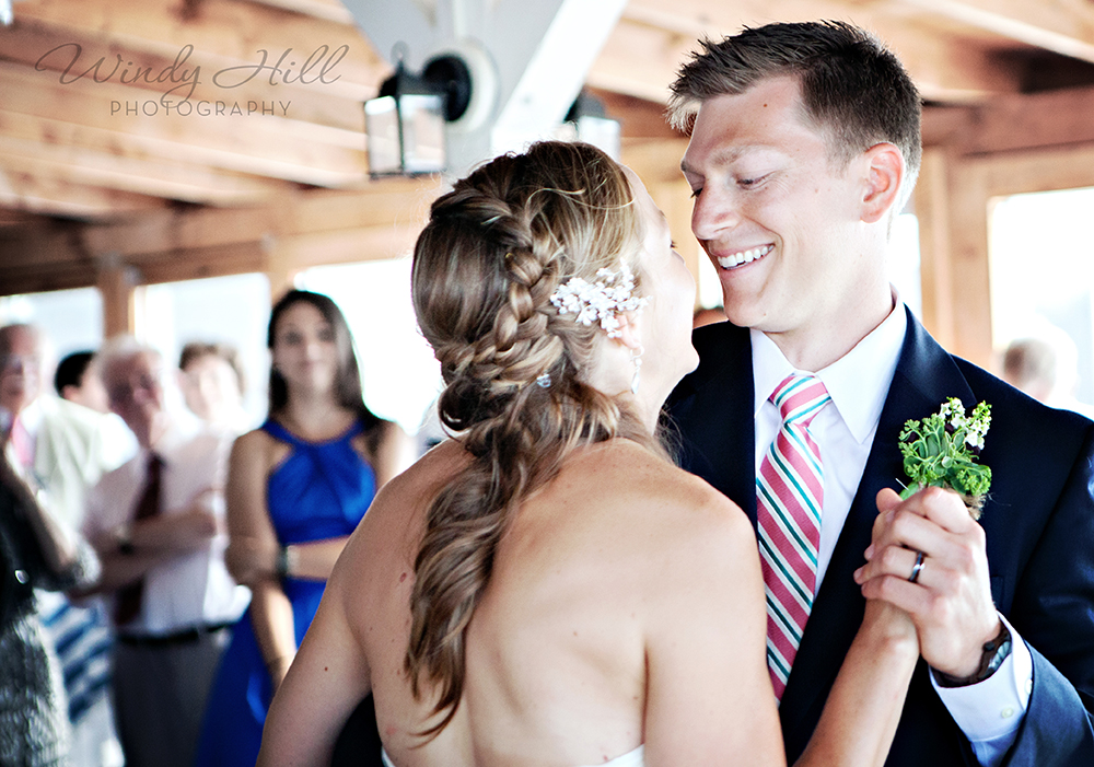 Maine Wedding Photographer contented sole first dance groom looks at bride.jpg