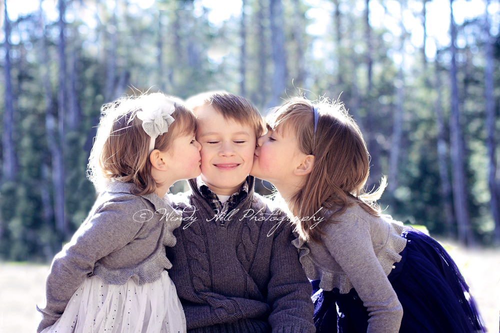 Maine Family Photographer kissing siblings.jpg