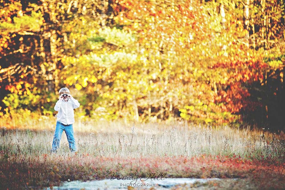 Maine Kids Photographer boy field sunset fall colors duck hunting binoculars.jpg