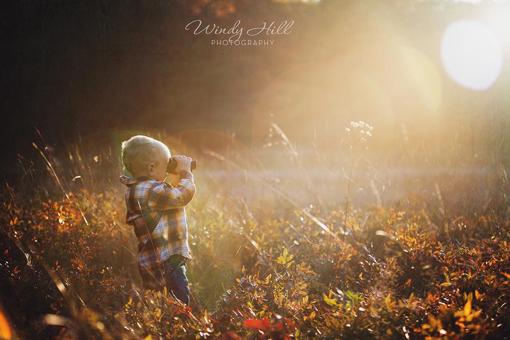 Maine Kids Photographer boys will be boys looking for ducks field sunset baby boy.jpg