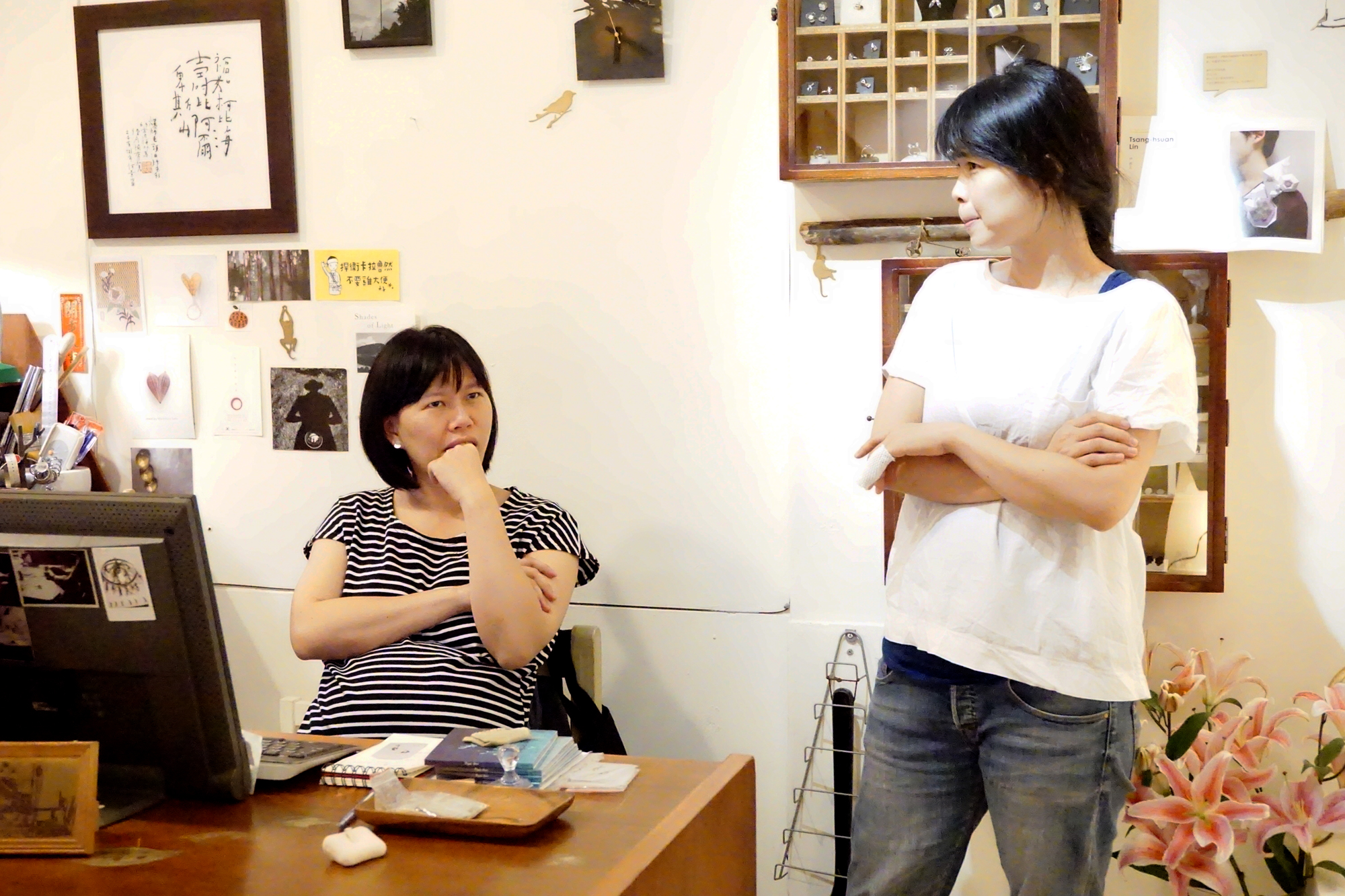 Peggy (on the left) and Ting-Ting (on the right) thinking hard about a funny/interesting story with a client
