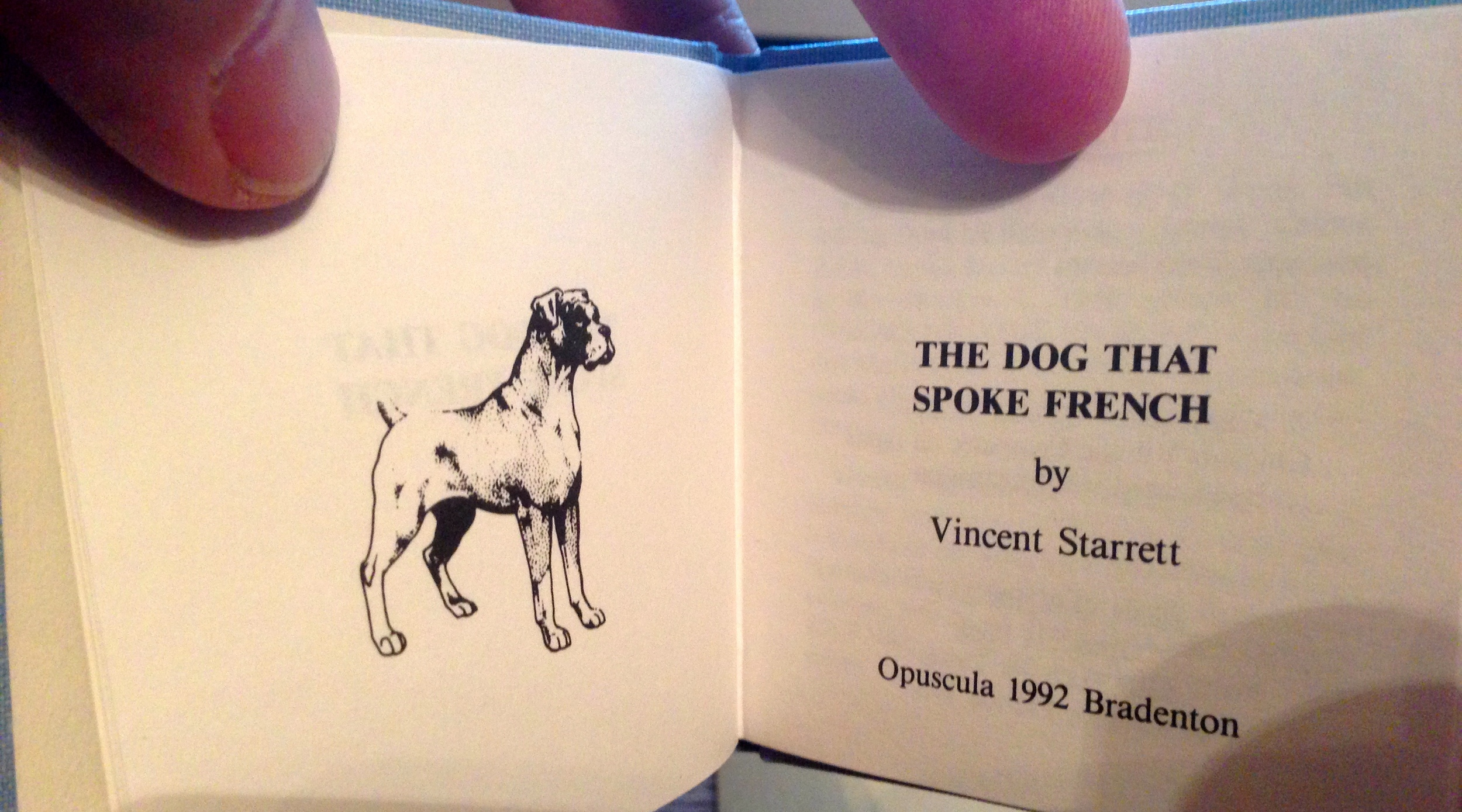 Title page of the miniature edition. Ignore my fat fingers.