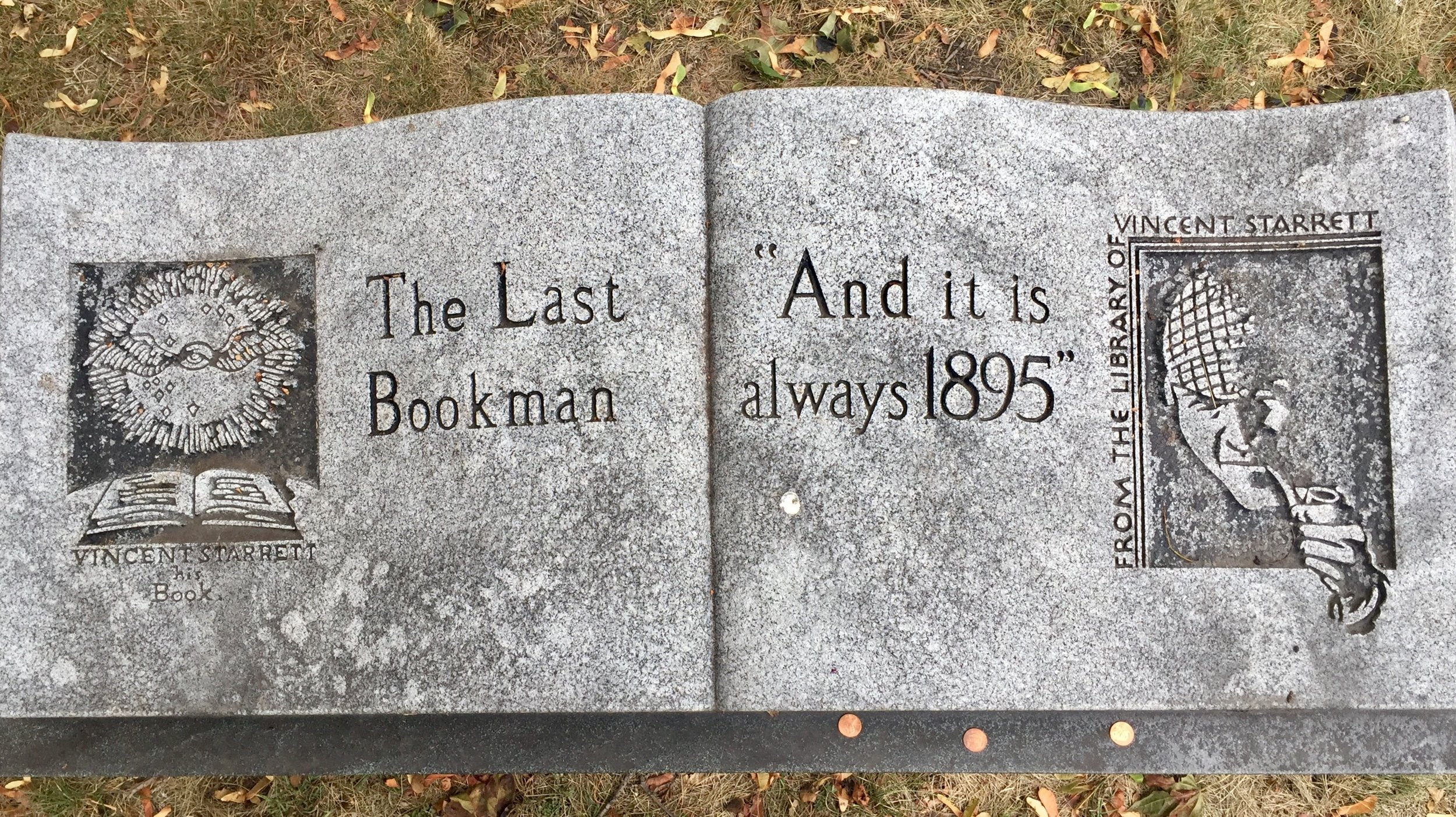 """Vincent Starrett's headstone as it looks today in Graceland Cemetery, Chicago. I took this photo in October. Looking down from the top, the stone looks like a large book, with iconic images on both """"pages."""" Time and weather are taking their toll on this final monument to Starrett and his wife. I did not leave the pennies."""