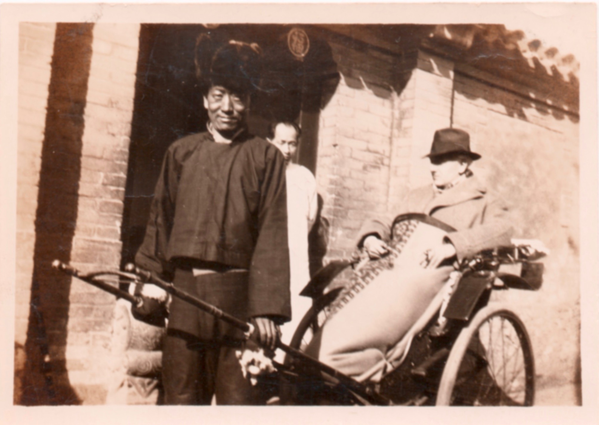 The fellow in white, hidden by the rickshaw driver, is Hsu, Starrett's chief servant while living in Peking. Notice that even while in China, Starrett still managed to find a cigar.