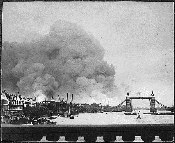 A photo of fires burning the day after a bombing. From the National Archives.