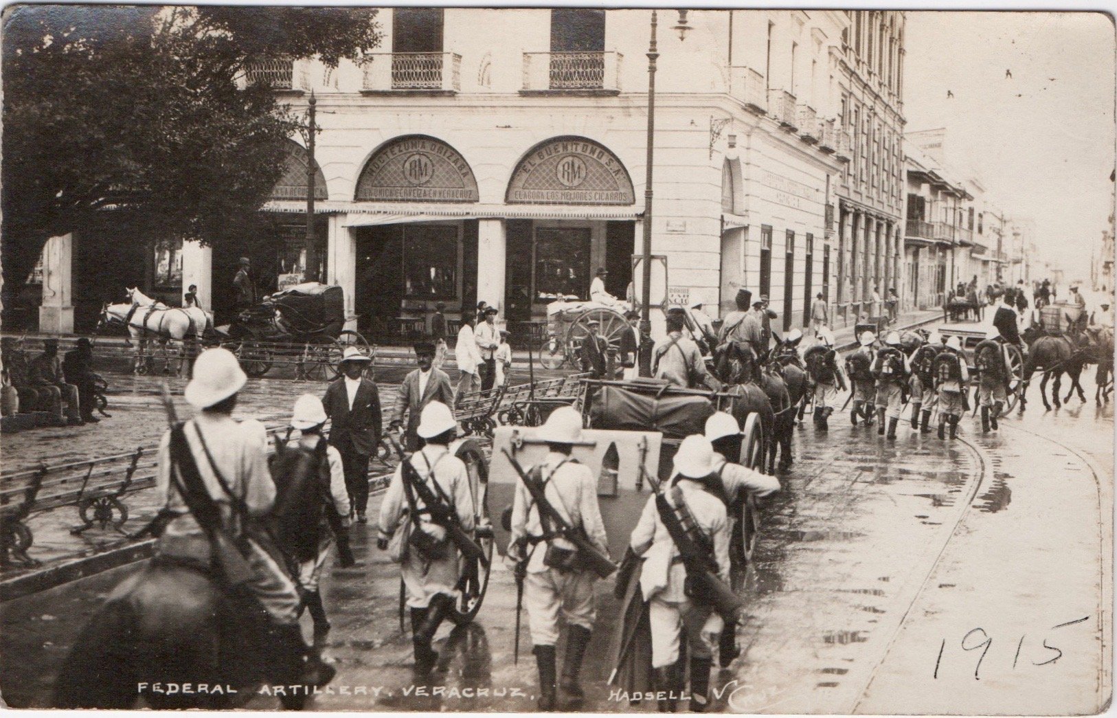A rather motley group of federal troops parade through Vera Cruz.