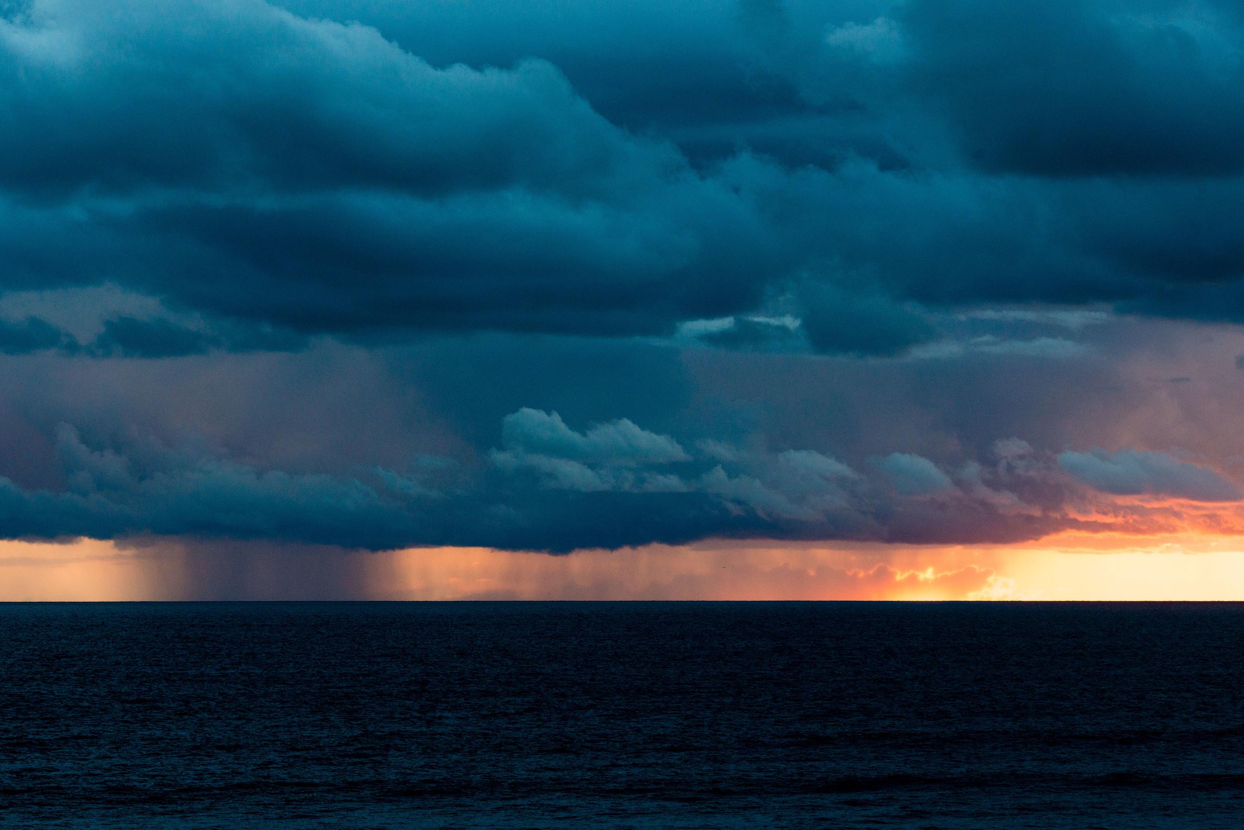 Rain column illuminated by the setting sun in Manhattan Beach, California