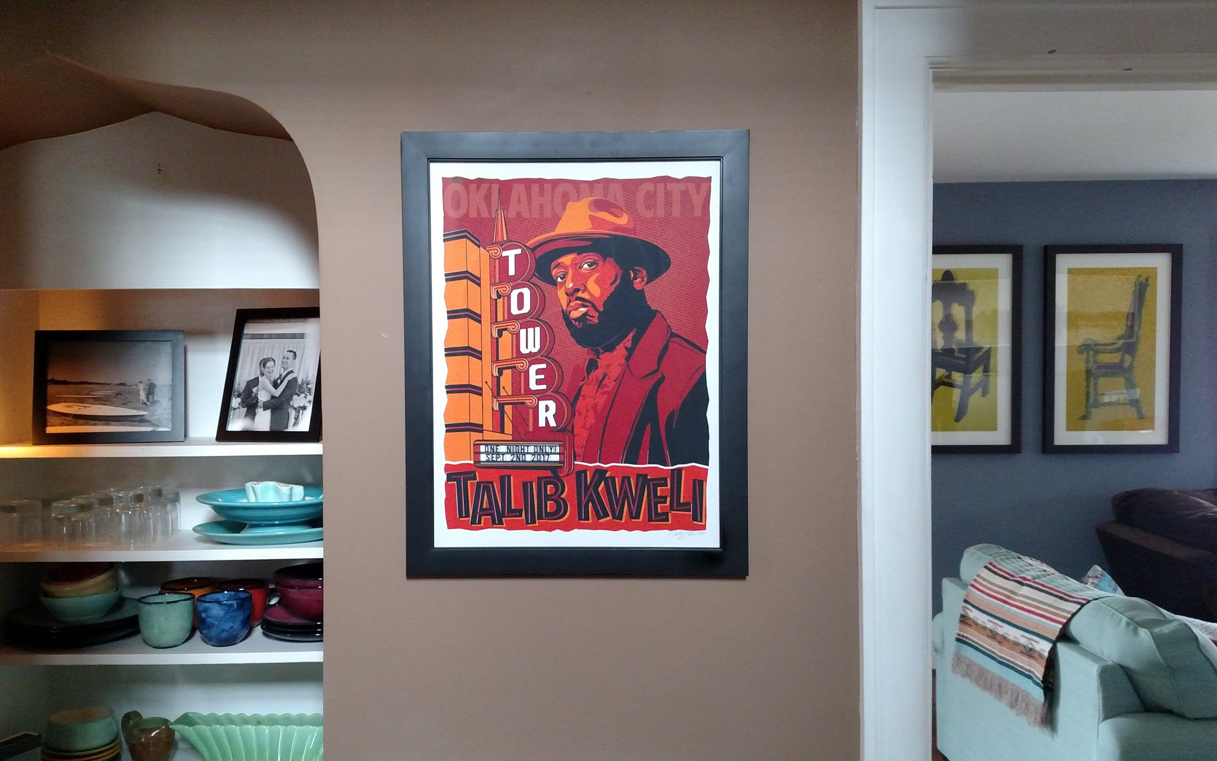 This is a limited edition screen print. We love this rapper and went to this concert on our anniversary. We framed it in a cheapo frame from Wal-Mart or something.