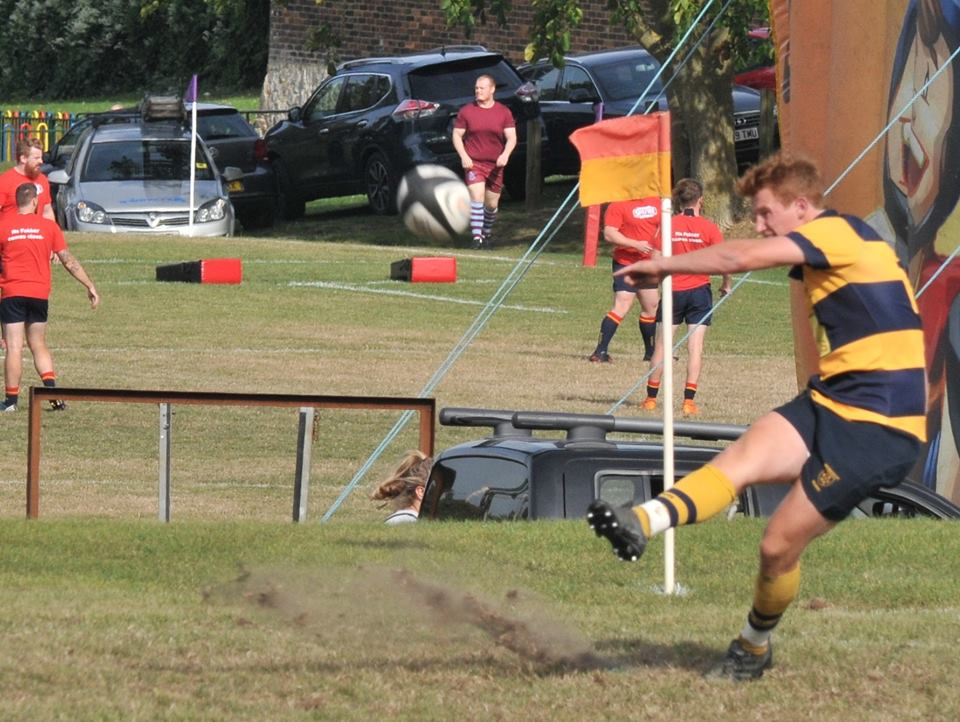 Dom Saunders knocks over a conversion. Photo Credit: Graham Henley