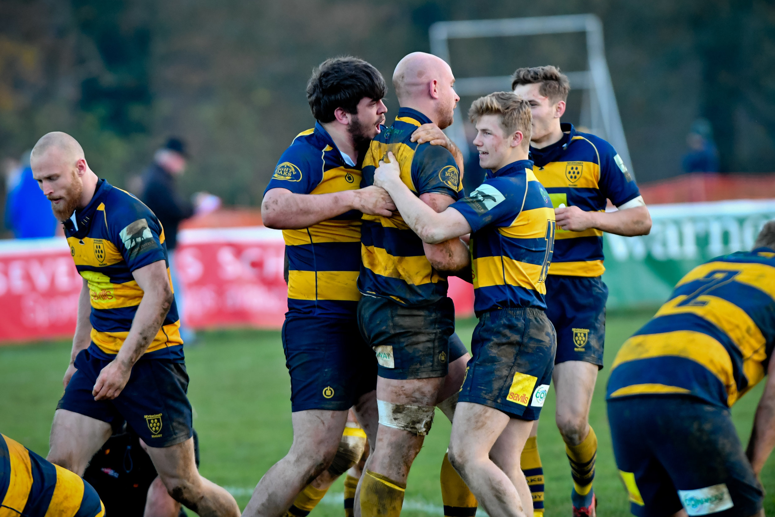 Captain Fantastic! Oaks Skipper Stuart Coleman is congratulated by team mates Matt Simmons and debutant Henry Carter after scoring Oaks try. Photo Credit: David Purday